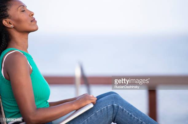 calm freelancer woman working outdoors, taking a short break. - beautiful israeli women stock pictures, royalty-free photos & images