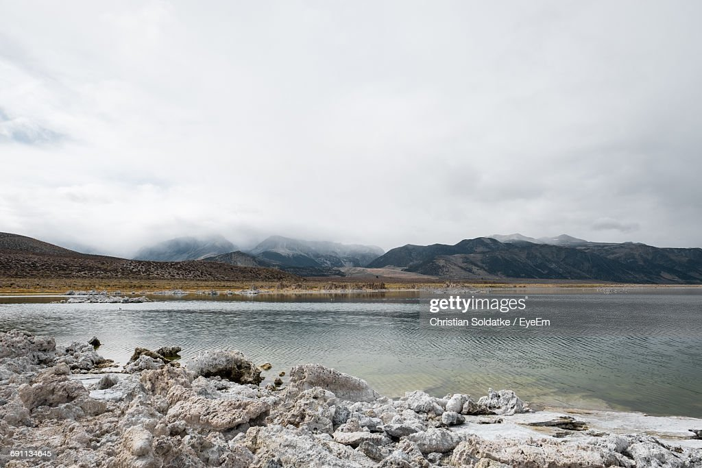 Calm Lake Against Mountain Range : Stock-Foto