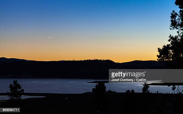 calm lake along silhouette landscape - overberg stock pictures, royalty-free photos & images