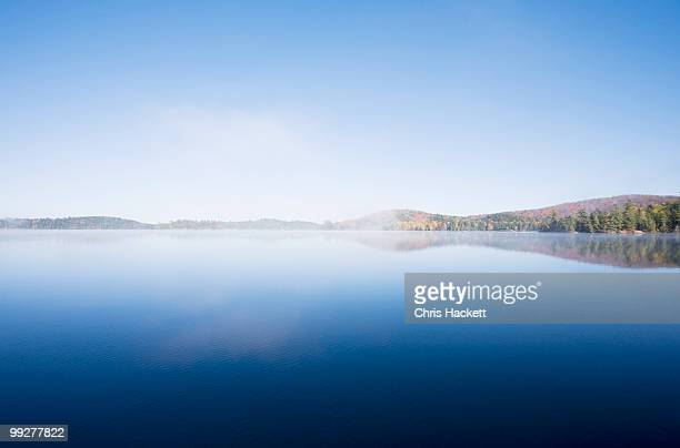 calm lake - hackett stock photos and pictures