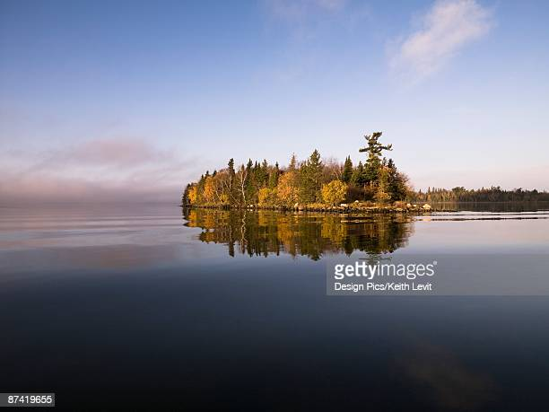 calm lake water - lake of the woods stock pictures, royalty-free photos & images