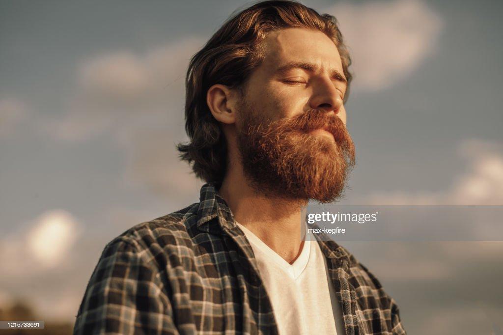 Calm man meditating in sunny summer day : Stock Photo