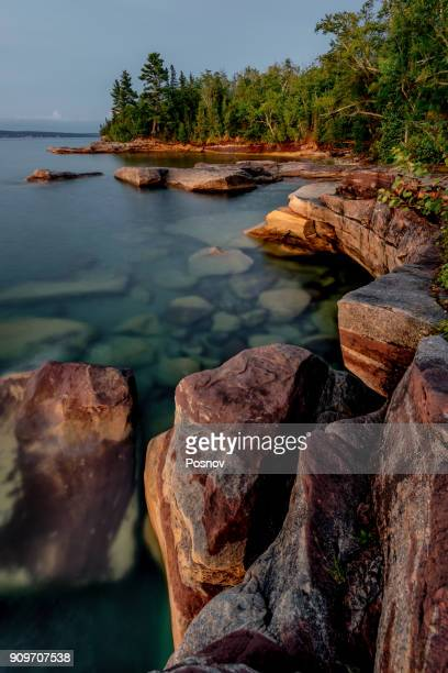calm moning waters of lake superior - munising michigan stock pictures, royalty-free photos & images