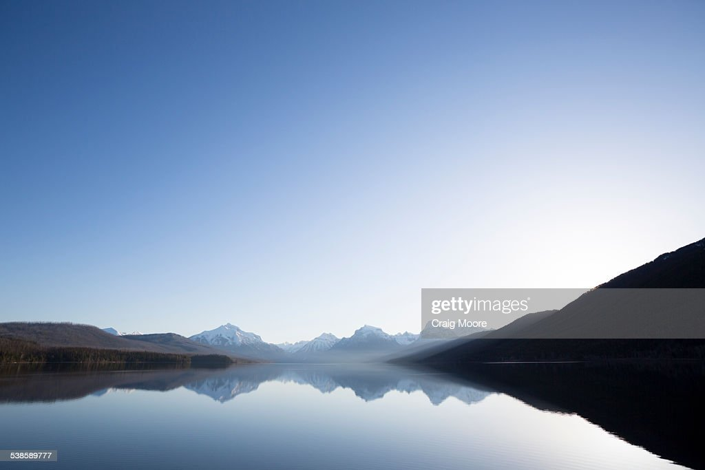 A calm morning before sunrise on Lake McDonald in Glacier National Park. : ストックフォト