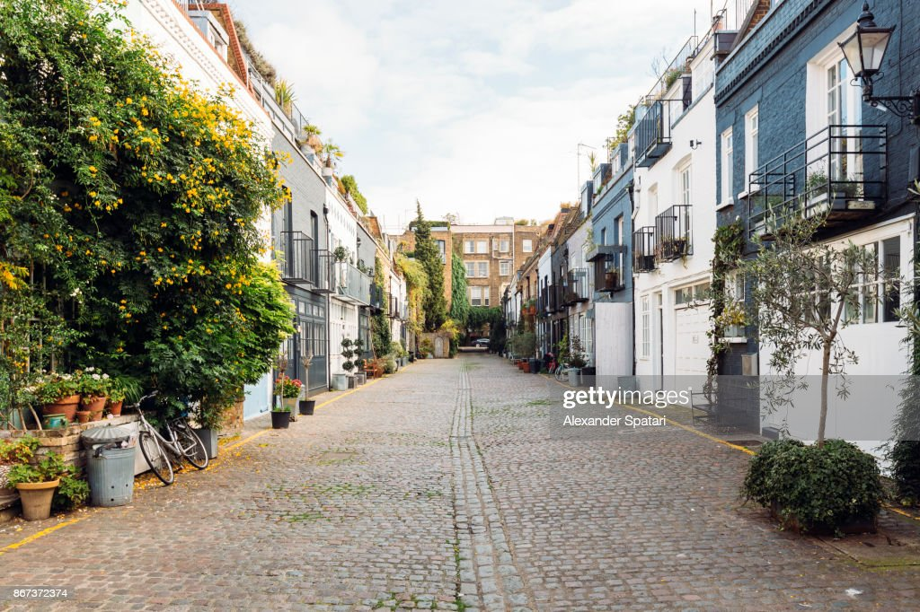 Calm street with mews houses in Notting Hill, London, Greater London, UK : Stock Photo