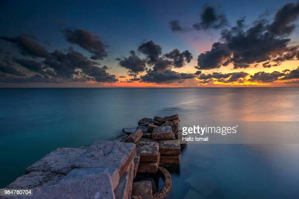 calm sunset at mabul island - mabul island stock photos and pictures