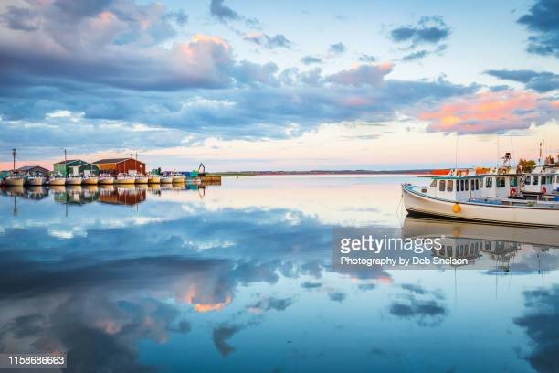 calm water at malpeque harbor - prince edward island canada - twilight stock pictures, royalty-free photos & images