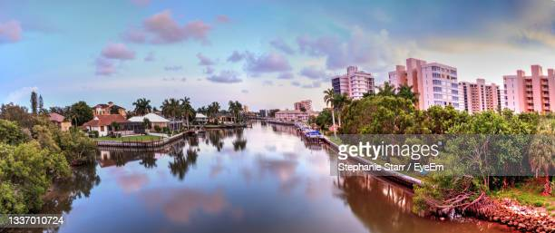 calm water at sunset over wiggins pass on the riverway out to delnor wiggins state park - florida us state stock pictures, royalty-free photos & images
