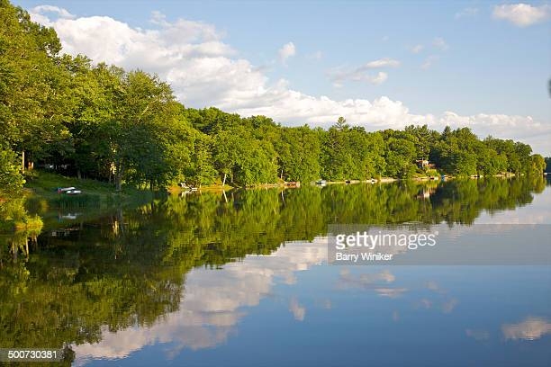 calm water with shoreline reflection - barry wood stock pictures, royalty-free photos & images