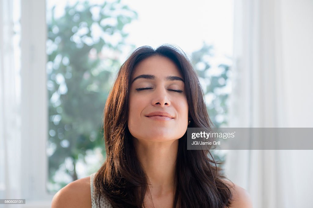 Calm woman breathing with eyes closed : Stock Photo