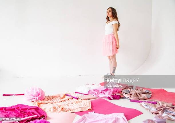 calm woman in studio with pink clothes - tulle netting stock pictures, royalty-free photos & images