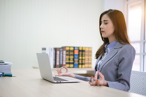 Calm woman relaxing meditating with laptop, no stress free relief at work concept, mindful peaceful young businesswoman or student practicing breathing yoga exercises at workplace, office meditation - gettyimageskorea