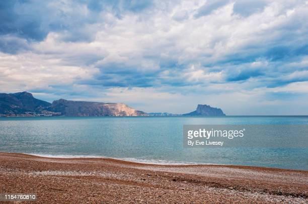 calpe as seen from albir beach - カルペ ストックフォトと画像