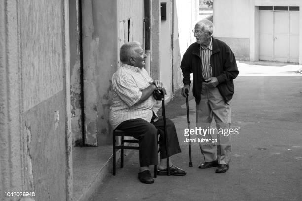 Caltagirone, Sicily: Two Senior Men Chat
