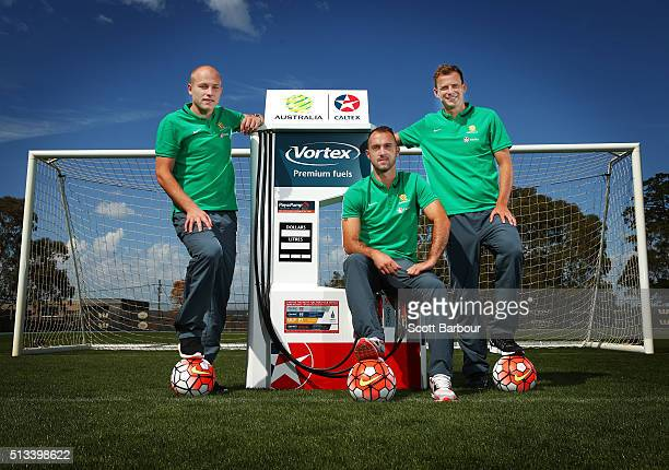 Caltex Socceroos players Aaron Mooy Ivan Franjic and Alex Wilkinson pose during a Socceroos sponsorship announcement at Melbourne City Training...