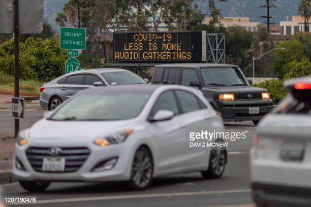 A Caltrans Changeable Message Sign warns motorists along California State Route 135 to avoid gatherings as the threat of Coronavirus disease...