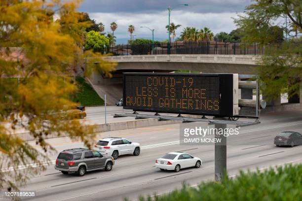 A Caltrans Changeable Message Sign warns motorists on the Interstate 5 freeway to not gather in crowds as the threat of Coronavirus disease increases...