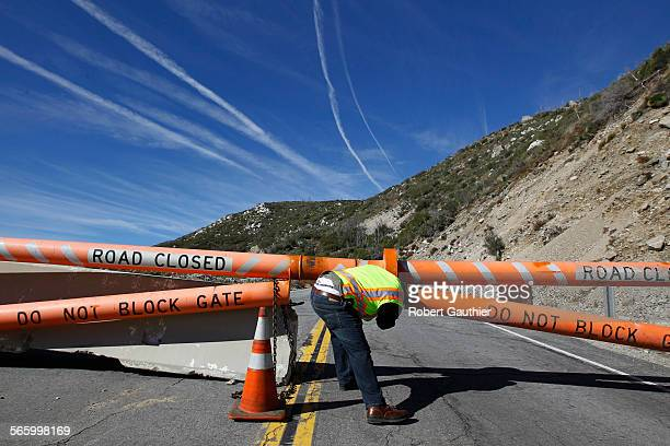 Caltrans spokesman Patrick Chandler unlocks a gate blocking access to a section of Highway 39 that has been closed for 30 years. CalTrans plans to...