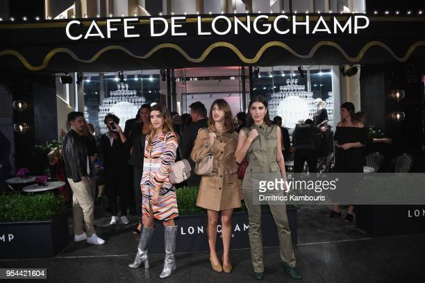 Calu Rivero Jeanne Damas and Patricia Manfield attend the opening of Longchamp Fifth Avenue Flagship at Longchamp on May 3 2018 in New York City