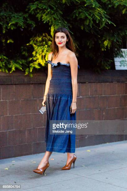 Calu Rivero wears a denim Anija Stella McCartney dress outside the Stella McCartney Spring 18 presentation on June 8 2017 in New York City