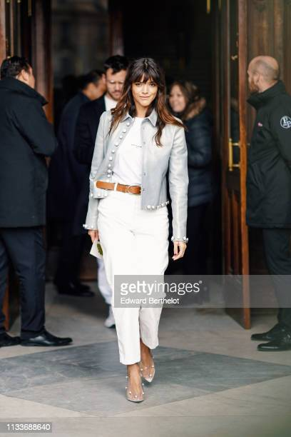 Calu Rivero wears a gray button jacket white pants outside Stella McCartney during Paris Fashion Week Womenswear Fall/Winter 2019/2020 on March 04...