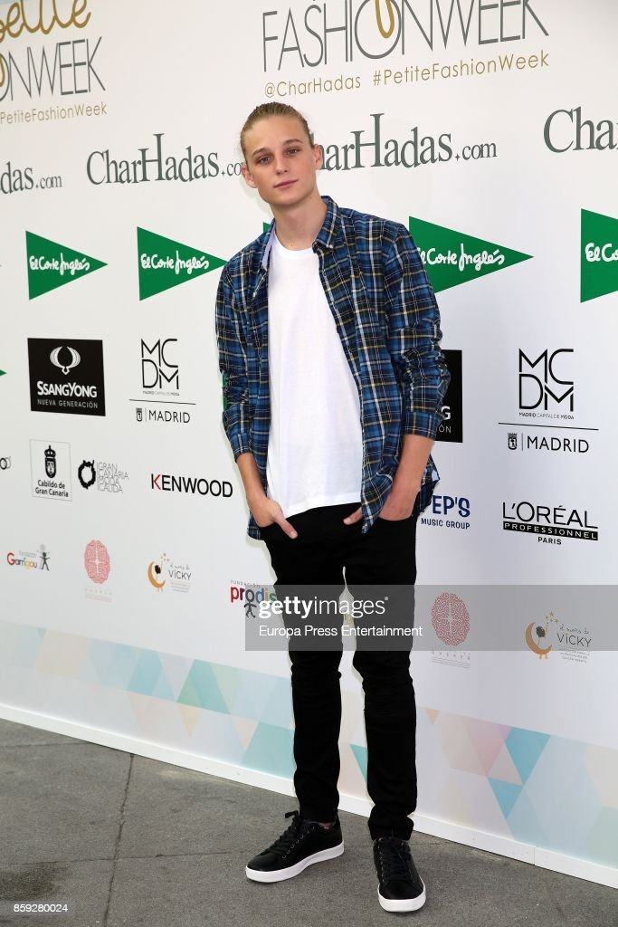 Calum attends 'The Petite Fashion Week' Photocall at Cibeles Palace on October 6, 2017 in Madrid, Spain.