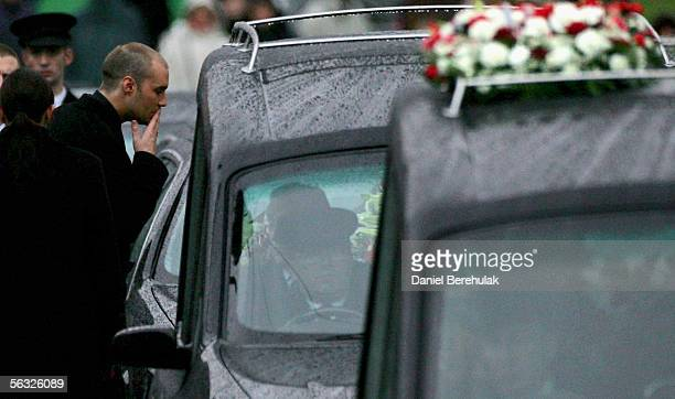 Calum Best blows a kiss to his father's coffin before the funeral cortege for footballer George Best makes its way from the private service held at...