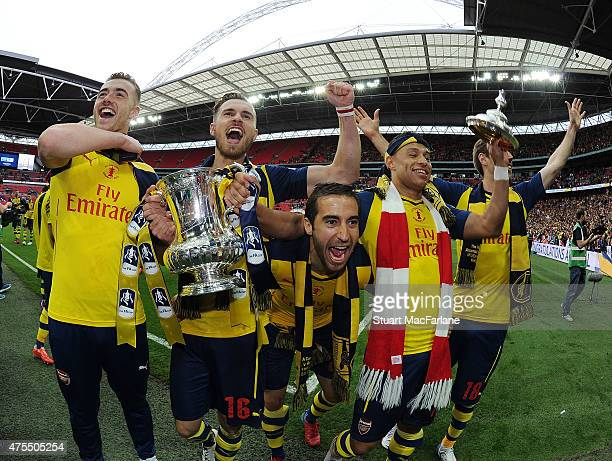 Calum Chambers Aaron Ramsey Mathieu Flamini Alex OxladeChamberlain and Nacho Monreal celebrate after the FA Cup Final between Aston Villa and Arsenal...