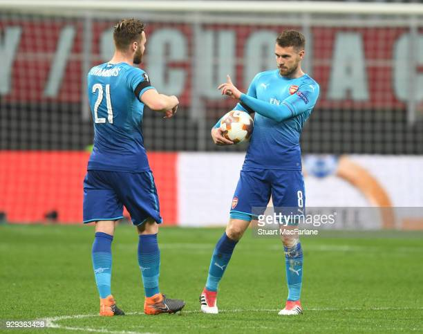 Calum Chambers and Aaron Ramsey of Arsenal during UEFA Europa League Round of 16 match between AC Milan and Arsenal at the San Siro on March 8 2018...