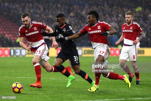 Calum Chambers and Adama Traore of Middlesbrough in action with Ademola Lookman of Everton during the Premier League match between Middlesbrough and...