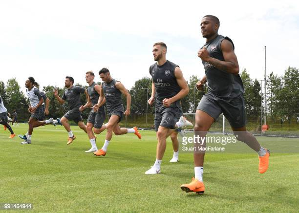 Calum Chambers and Chuba Akpom of Arsenal run during a training session at London Colney on July 4 2018 in St Albans England