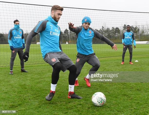 Calum Chambers and Jack Wilshere of Arsenal during a training session at London Colney on January 23 2018 in St Albans England