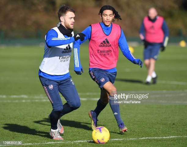 Calum Chambers and Kido Taylor-Hart of Arsenal during a training session at London Colney on January 25, 2021 in St Albans, England.