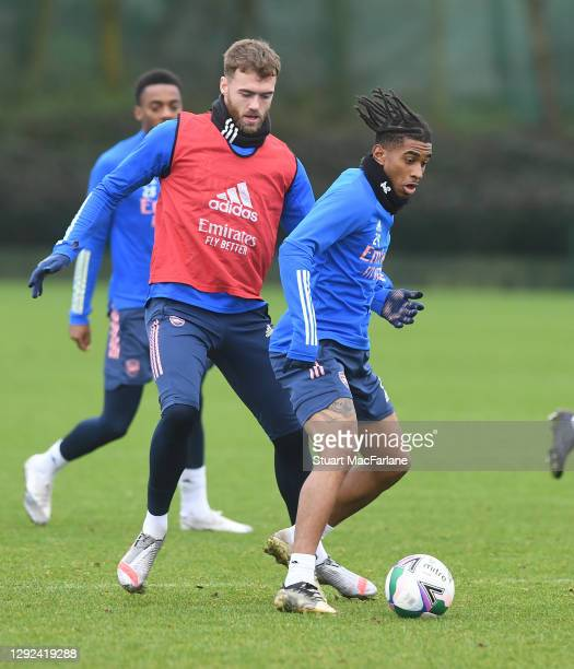 Calum Chambers and Reiss Nelson of Arsenal during a training session at London Colney on December 21, 2020 in St Albans, England.
