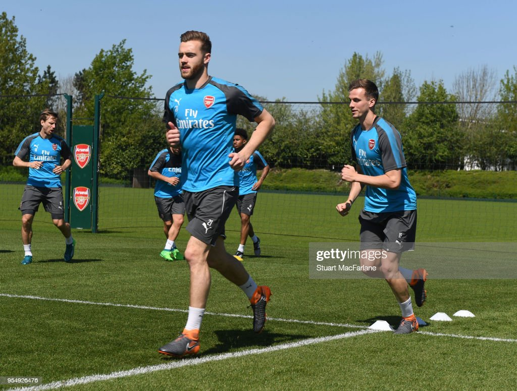 (L-R0 Calum Chambers and Rob Holding of Arsenal during a training session at London Colney on May 5, 2018 in St Albans, England.