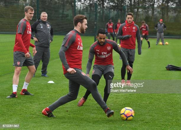 Calum Chambers and Theo Walcott of Arsenal during a training session at London Colney on November 4 2017 in St Albans England