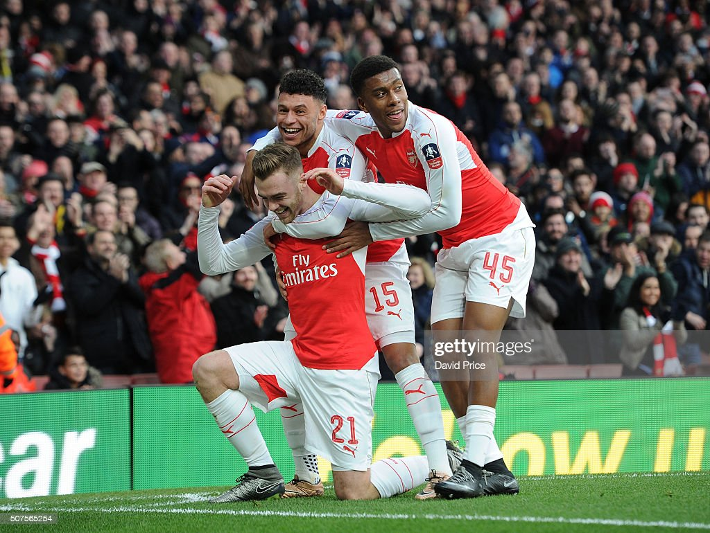Calum Chambers celebrates scoring a goal for Arsenal with alex Oxlade-Chamberlain and Alex Iwobi during the Emirates FA Cup Fourth Round match between Arsenal and Burnley in the FA Cup 4th round at Emirates Stadium on January 30, 2016 in London, England.