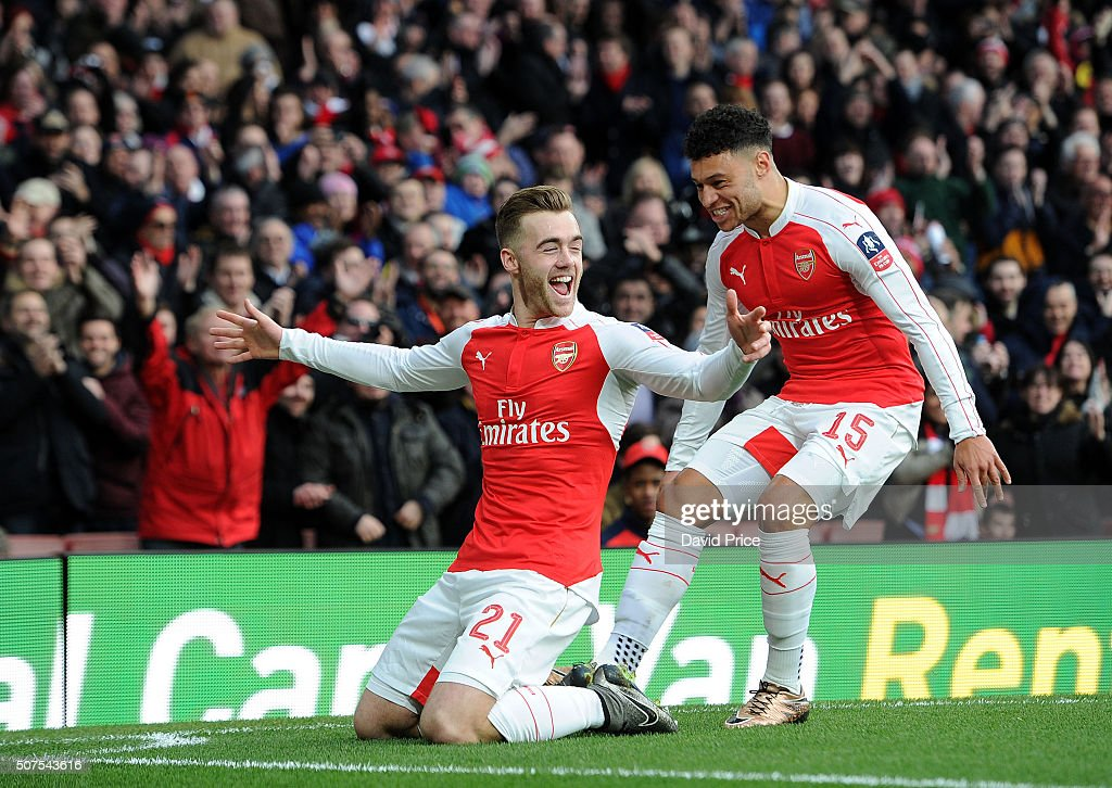 Calum Chambers celebrates scoring a goal for Arsenal with team-mate Alex Oxlade-Chamberlain during the match between Arsenal and Burnley in the FA Cup 4th round at Emirates Stadium on January 30, 2016 in London, England.