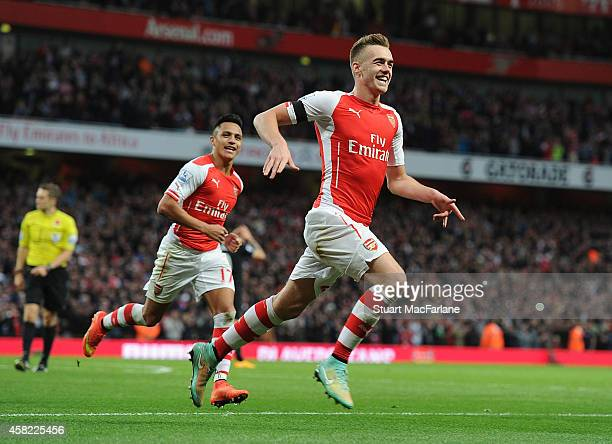 Calum Chambers celebrates scoring the 2nd Arsenal goal during the Barclays Premier League match between Arsenal and Burnley at Emirates Stadium on...