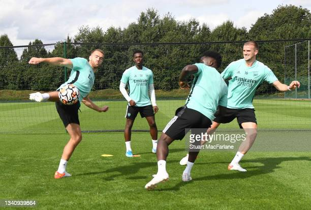 Calum Chambers, Eddie Nketiah, Bukayo Saka and Rob Holding of Arsenal during a training session at London Colney on September 17, 2021 in St Albans,...
