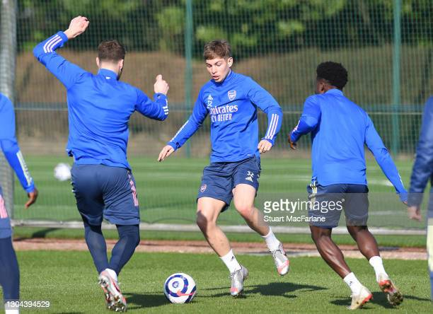 Calum Chambers, Emile Smith Rowe and Bukayo Saka of Arsenal during a training session at London Colney on February 27, 2021 in St Albans, England.