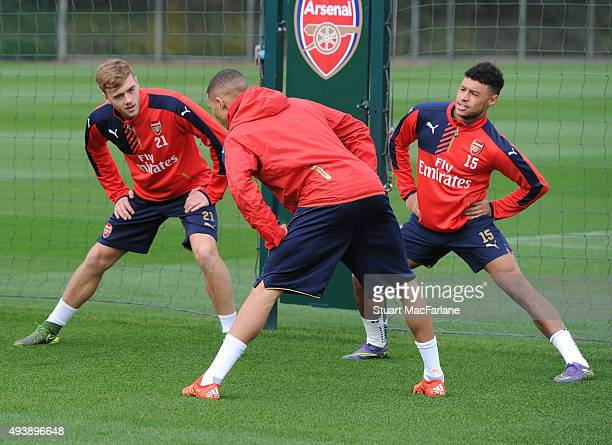 Calum Chambers Kieran Gibbs and Alex OxladeChamberlain of Arsenal during a training session at London Colney on October 23 2015 in St Albans England