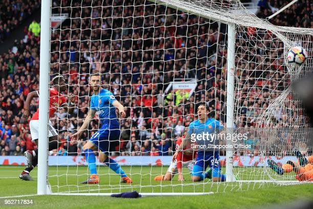 Calum Chambers of Arsenal and Hector Bellerin of Arsenal look dejected as Paul Pogba of Man Utd scores their 1st goal during the Premier League match...