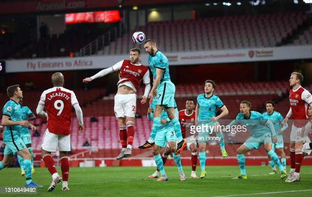 Calum Chambers of Arsenal and Nathaniel Phillips of Liverpool compete for a header during the Premier League match between Arsenal and Liverpool at...