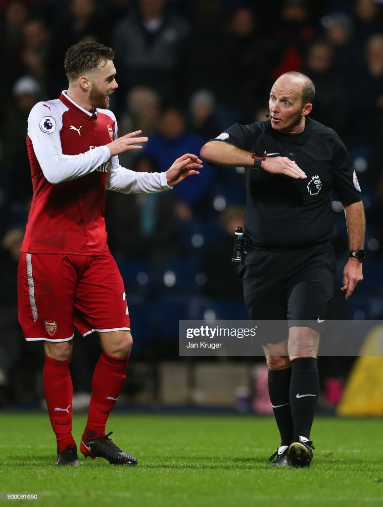 Calum Chambers of Arsenal appeals as referee Mike Dean awards a penalty against him during the Premier League match between West Bromwich Albion and Arsenal at The Hawthorns on December 31, 2017 in West Bromwich, England.