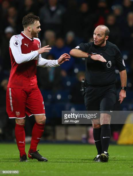 Calum Chambers of Arsenal appeals as referee Mike Dean awards a penalty against him during the Premier League match between West Bromwich Albion and...