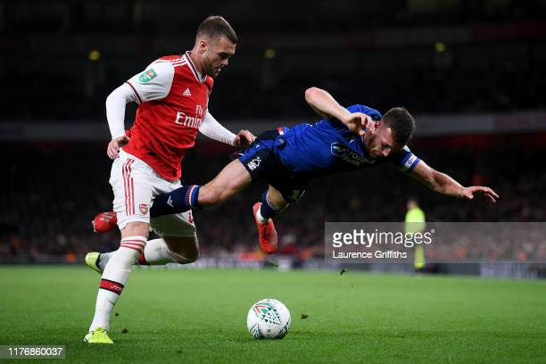 Calum Chambers of Arsenal battles for the ball with Jack Robinson of Nottingham Forest during the Carabao Cup Third Round match between Arsenal FC...