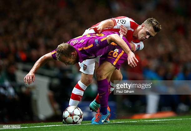 Calum Chambers of Arsenal battles for the ball with Semih Kaya of Galatasaray AS during the UEFA Champions League group D match between Arsenal FC...