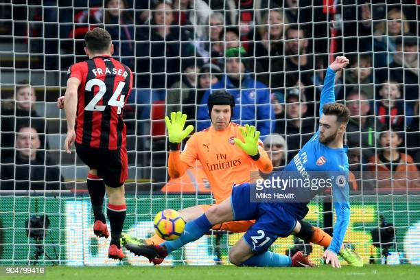 Calum Chambers of Arsenal blocks a shot from Ryan Fraser of AFC Bournemouth during the Premier League match between AFC Bournemouth and Arsenal at...