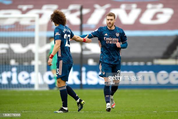 Calum Chambers of Arsenal celebrates his side's second goal with David Luiz of Arsenal during the Premier League match between West Ham United and...